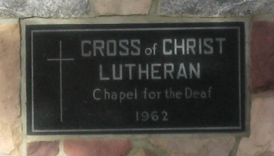 Plaque on outside wall of church